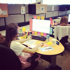 Tori Nation, 8th floor sales representative, on the phone with a client.